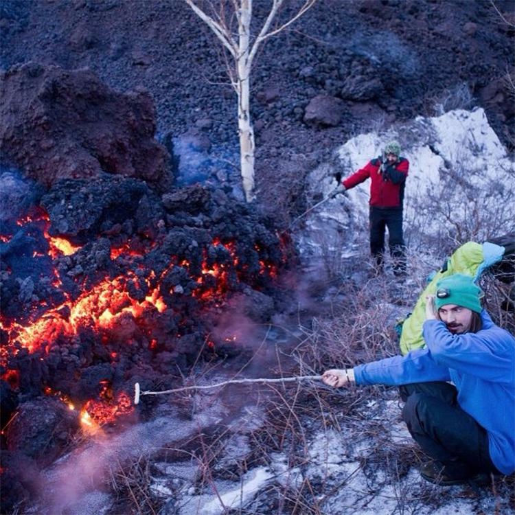 Photo by Olga Stryukova olya_stryukova_Tourists fry sausages on the lava near Tolbachik 2012 g.jpg