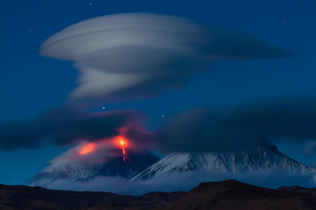 Photo by Denis Budkov. The eruption of Klyuchevskoy volcano and an amazing lenticular cloud above its peak. 2010 g.jpg