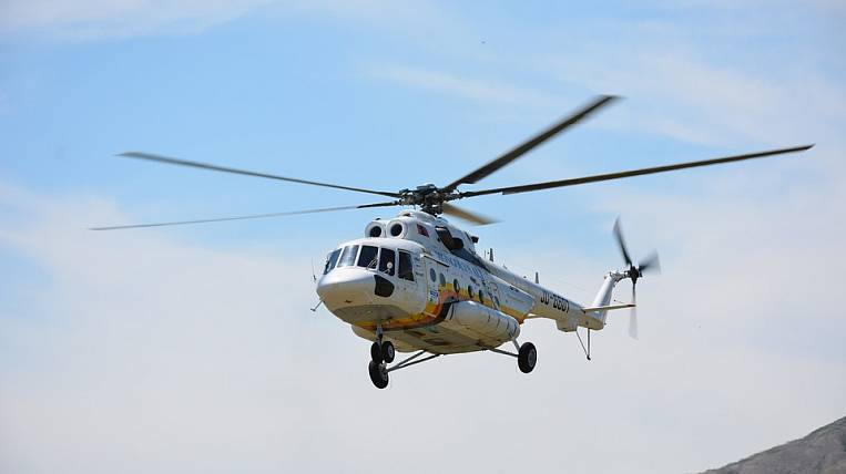 In Kamchatka, an EMERCOM helicopter flew in search of three missing fishermen